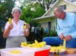 Peggy and husband, Charles, shuck corn